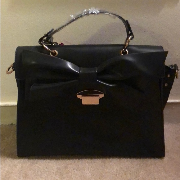 Handbags - Never worn. Black hand bag with bow detail